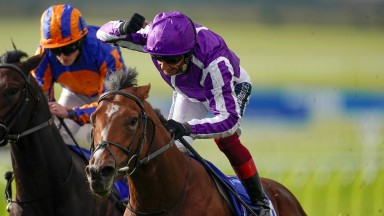 NEWMARKET, ENGLAND - OCTOBER 10: Frankie Dettori celebrates as he rides St Mark's Basillica to win The Darley Dewhurst Stakes from Ryan Moore and Wembley (L, orange/blue) at Newmarket Racecourse on October 10, 2020 in Newmarket, England. Owners are allowe
