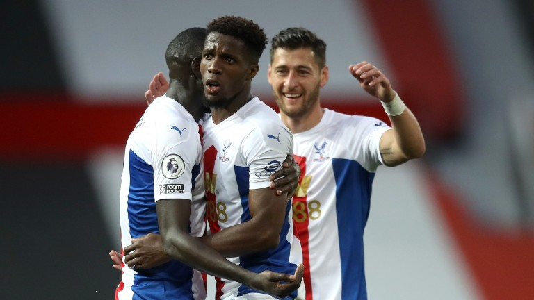 Wilfried Zaha celebrates Crystal Palace's third goal against Manchester United