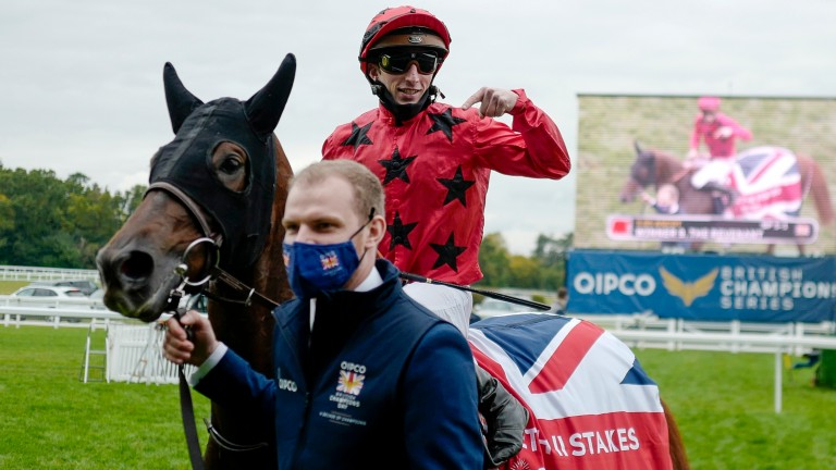 Pierre-Charles Boudot gives thanks to The Revenant after their victory in the QEII