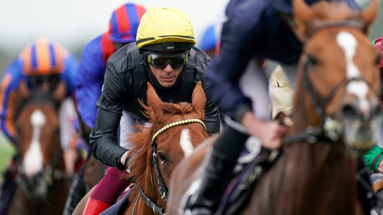 Frankie Dettori stalks the leaders on Stradivarius, but the favourite put up a very disappointing display, reportedly not handling the ground