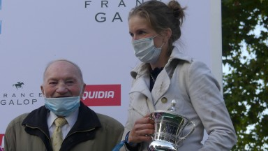 Trainer Louisa Carberry and owner Robert Gasche-Luc after winning France's premier jumps race, the Grand Steeple-Chase de Paris, with Docteur De Ballon