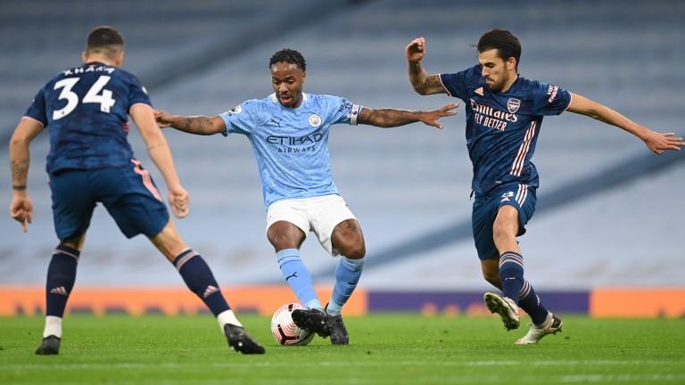 Man City's Raheem Sterling dribbles against Arsenal