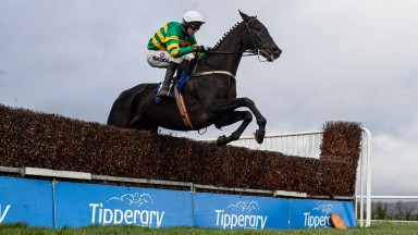 Unexcepted and Mark Walsh jump the last en route to landing the beginners chase at Tipperary