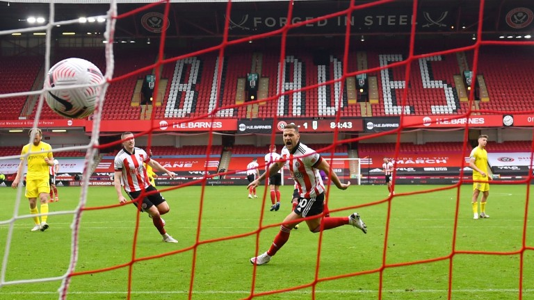 Billy Sharp puts away a penalty for Sheffield United