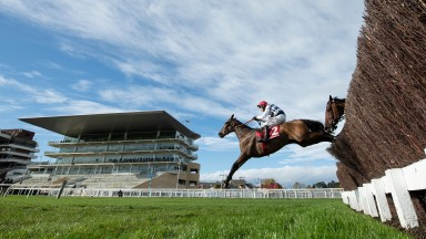 Galvin (Robbie Power) jumps the last fence and wins the 3m novices' chaseCheltenham 23.10.20 Pic: Edward Whitaker/ Racing Post