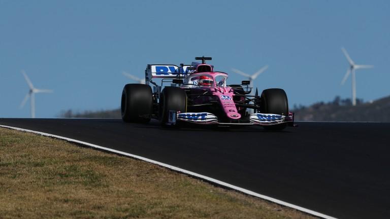 Sergio Perez crests a rise at the Portimao circuit