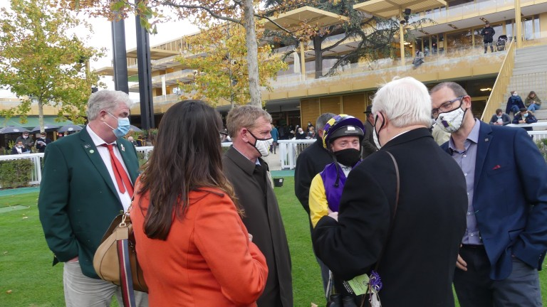Tony Mullins and Seamie Heffernan discuss tactics with the owners of Princess Zoe ahead of the Prix Royal-Oak