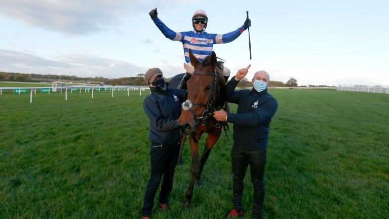 Cyrname and Harry Cobden are congratulated by Kate Nutt and Rodrigo Zanchi after winning the Charlie Hall Chase