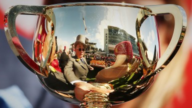 MELBOURNE, AUSTRALIA - NOVEMBER 07:  Owner Lloyd Williams is reflected in the Melbourne Cup trophy after Rekindling ridden by jockey Corey Brown won race 7 the 2017 Melbourne Cup during Melbourne Cup Day at Flemington Racecourse on November 7, 2017 in Mel