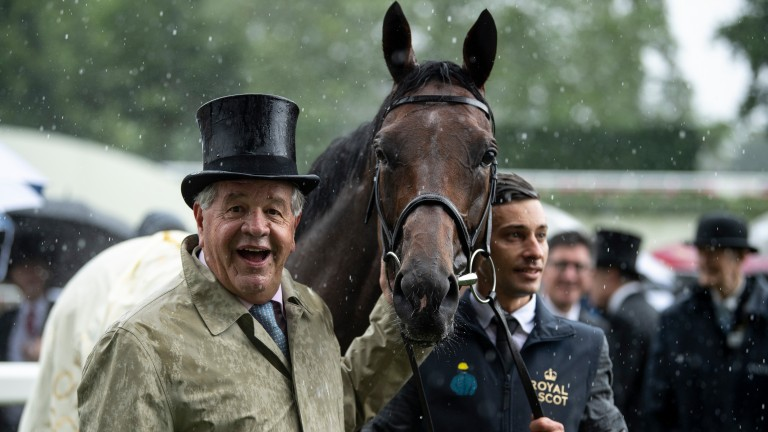 Sir Michael Stoute and Crystal Ocean in the rain after the Prince Of Wales's Stakes