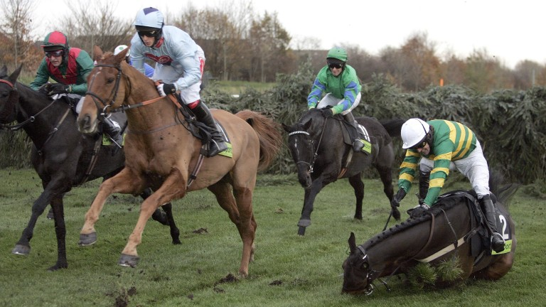 Eurotrek and Liam Heard (blue) en route to victory in the 2006 Becher Chase as Clan Royal crashes out