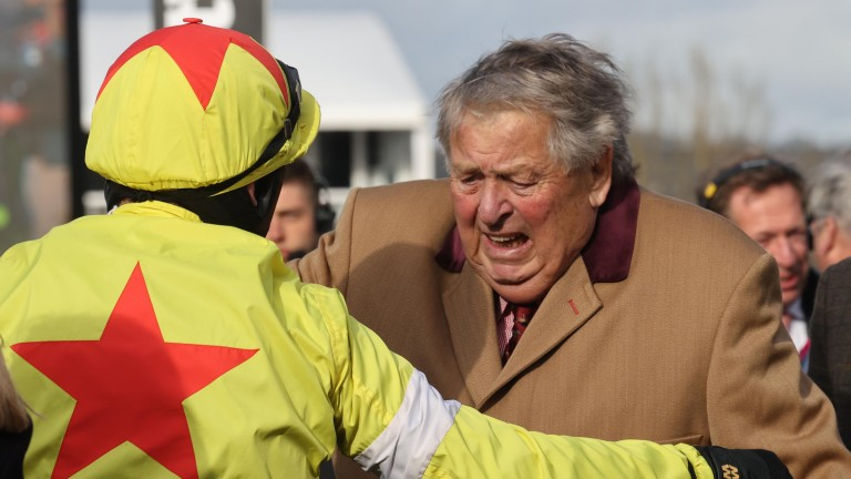 Politologue's owner John Hales is overcome with emotion as he embraces winning jockey Harry Skelton after the Champion Chase