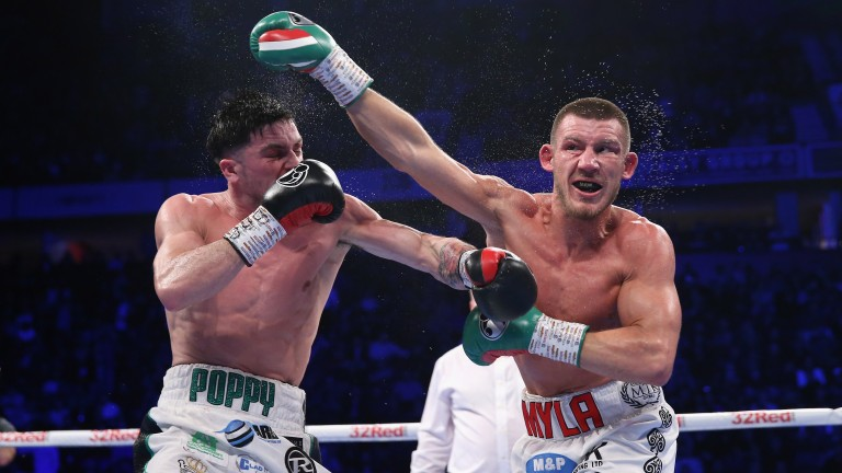 Mark Heffron (left) and Liam Williams trade punches