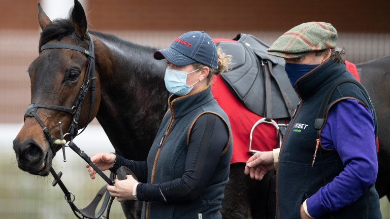 Epatante with Sophie Candy and trainer Nicky Henderson after her gallop at Newbury