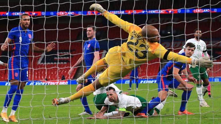 Ireland keeper Darren Randolph is beaten by a Harry Maguire header at Wembley