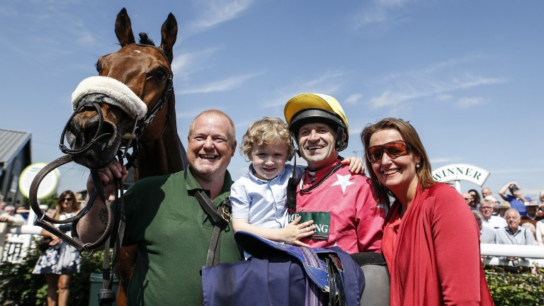 Andrew Thornton, after riding his 1,007th and last winner on Amirr at Uttoxeter, celebrates with son Harry and wife Yvonne