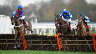 Bannixtown Glory ( David Bass,left) leads over the final flight and wins the listed mares' hurdle from Getaway Totherock (2nd right) and Indefatigable (right)Kempton 23.11.20 Pic: Edward Whitaker/Racing Post