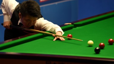 Zhou Yuelong is a hot favourite to silence Jimmy White on Saturday afternoon but the Whirwind could play his part in an entertaining clash