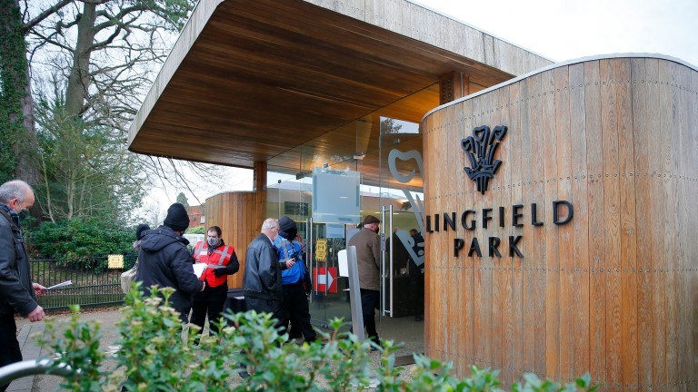 Crowds at Lingfield arrive at the entrance gates - the first time spectators have been seen at the Surrey track since March
