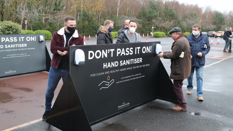 Crowds make use of the hand sanitiser station at Haydock
