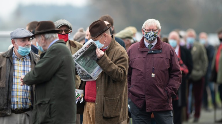Worth the wait: excited fans queue to enter the racecourse