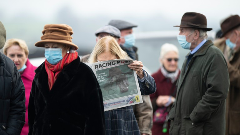 Familiar territory: reading the Racing Post on the first day back on a racecourse at Ludlow