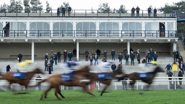 Racegoers watch the action in the opening race at Ludlow
