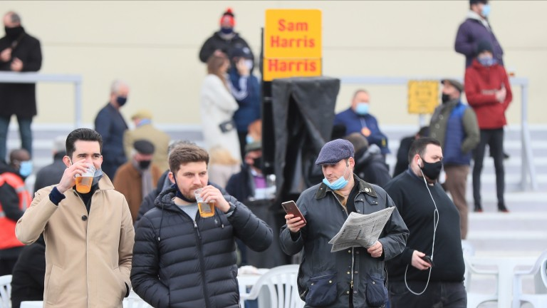 Racegoers at Lingfield enjoy a drink on course