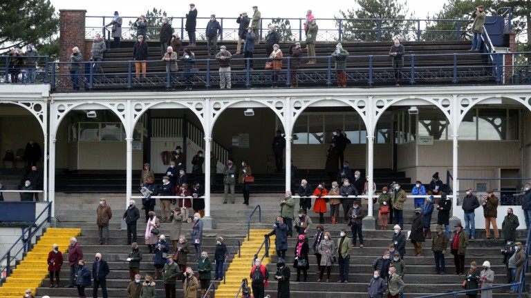 Spectators gather in the grandstand to watch the action at Ludlow