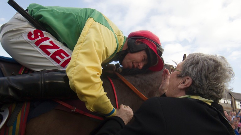 Andrew Lynch celebrates with the late Ann Potts after winning aboard Sizing Europe at the 2014 Punchestown festival