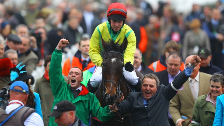 Cheltenham cheer: Andrew Lynch and Sizing Europe return to a great reception after winning the 2011 Queen Mother Champion Chase