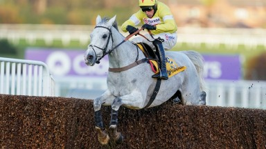 ESHER, ENGLAND - DECEMBER 05: Harry Skelton riding Politologue clear the last to win The Betfair Tingle Creek Chase at Sandown Park on December 05, 2020 in Esher, England. Owners and a limited number of the public are allowed to attend the meeting due to