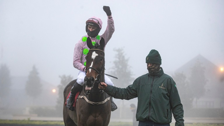 Min and Patrick Mullins are led in amongst the Punchestown fog which forced the rest of the card to be abandoned