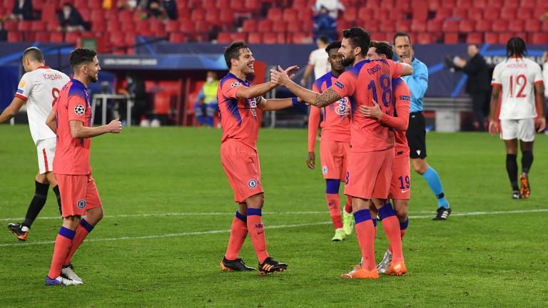 Chelsea celebrate Olivier Giroud's fourth goal in their 4-0 win at Sevilla