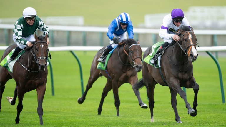 Supremacy (purple cap) streaks clear in the Group 1 Middle Park Stakes