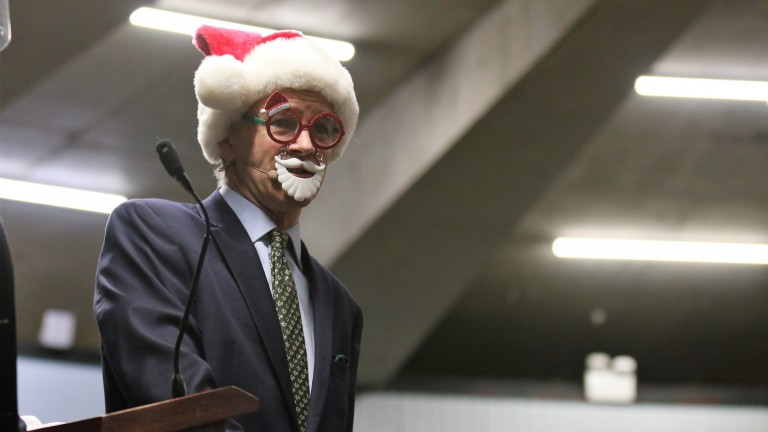 Henry Beeby dons a Santa Claus mask on the Goffs rostrum