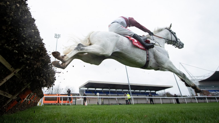 Silver Streak and Adam Wedge jump the last in the Christmas Hurdle
