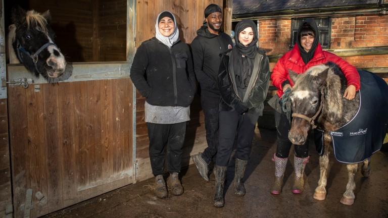 Freedom Zampaladus with his assistant Salwa Tebai and students Saarah Nazir and Shareefa