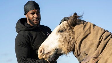 Freedom Tariq otherwise known as Fr33dom the founder of The Urban Equestrian Academy in the paddock with one of his horses at Scraptoft Hill Farm near Leicester 15.12.20Pic: Edward Whitaker