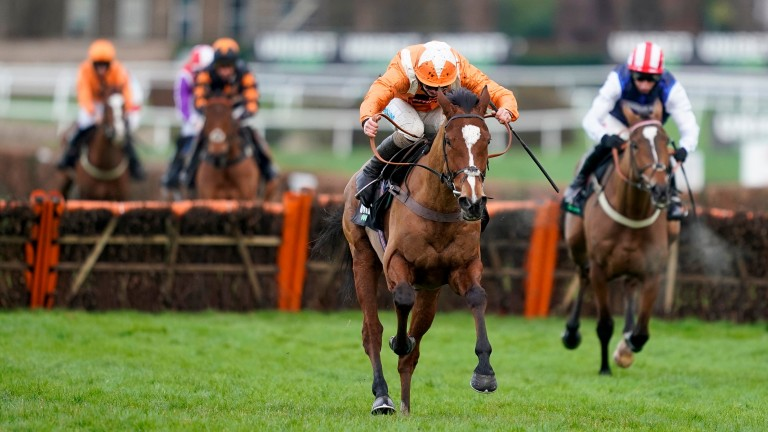 Metier sets off up the Sandown hill with the Tolworth Hurdle already in the bag
