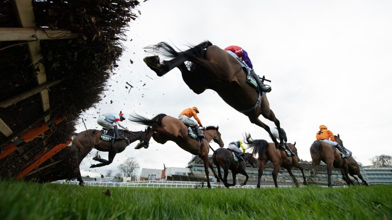 The winner Metier (Sean Bowen,4) jumps the second flight during their win in the Tolworth HurdleSandown 2.1.21 Pic: Edward Whitaker/ Racing Post