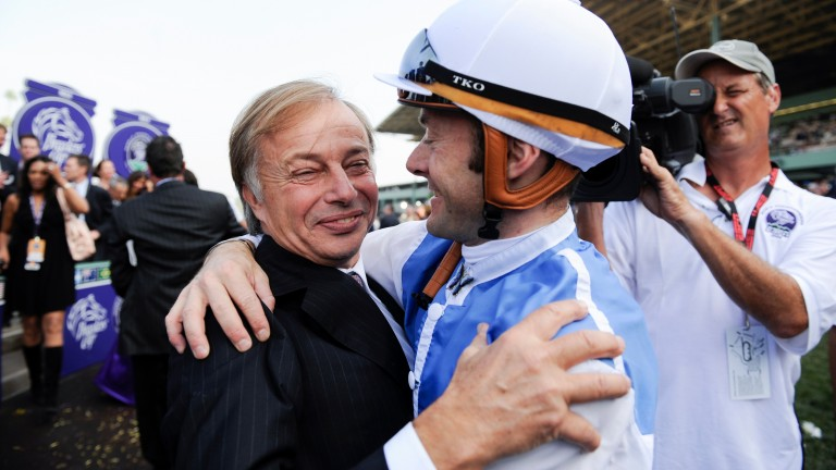 Freddy Head and Olivier Peslier celebrate after Goldikova's second win in the Breeders' Cup Mile