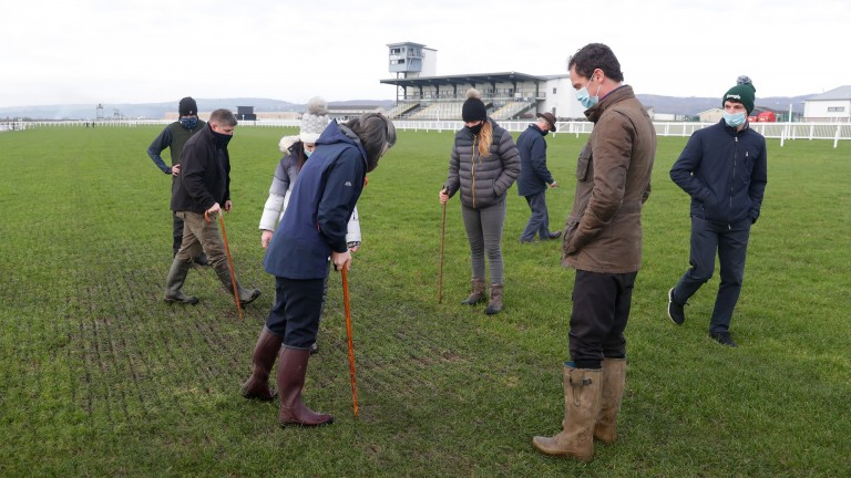 Jockeys, trainers and officials observe the course during the fourth inspection at Ffos Las