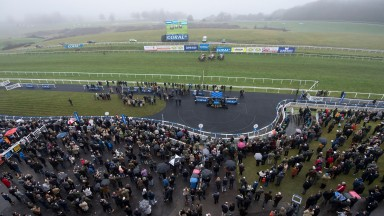 Runners in the 3m handicap hurdle race past the stands, the race was won by Eva's OskarChepstow 27.12.19 Pic: Edward Whitaker