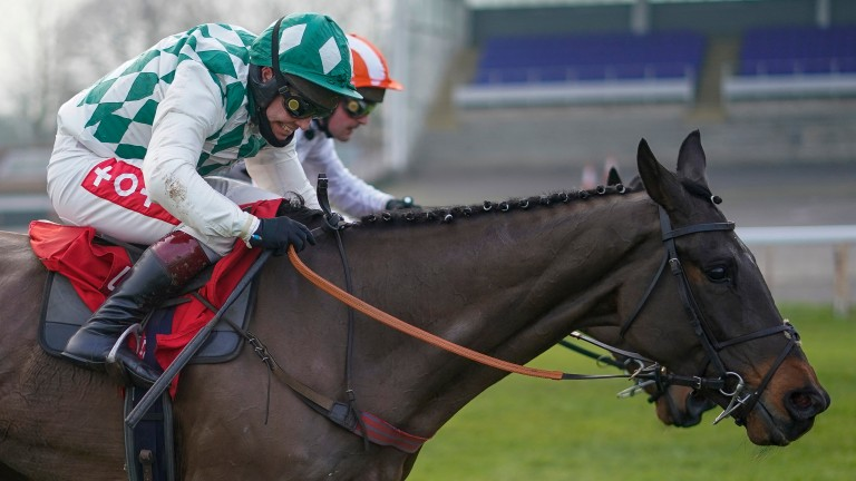 SUNBURY, ENGLAND - JANUARY 09: Richard Johnson riding Smarty Wild (L) clear the last to win The Ladbrokes Where The Nation Plays Handicap Chase from Nico de Boinville and Pistol Whipped at Kempton Park Racecourse on January 09, 2021 in Sunbury, England. D