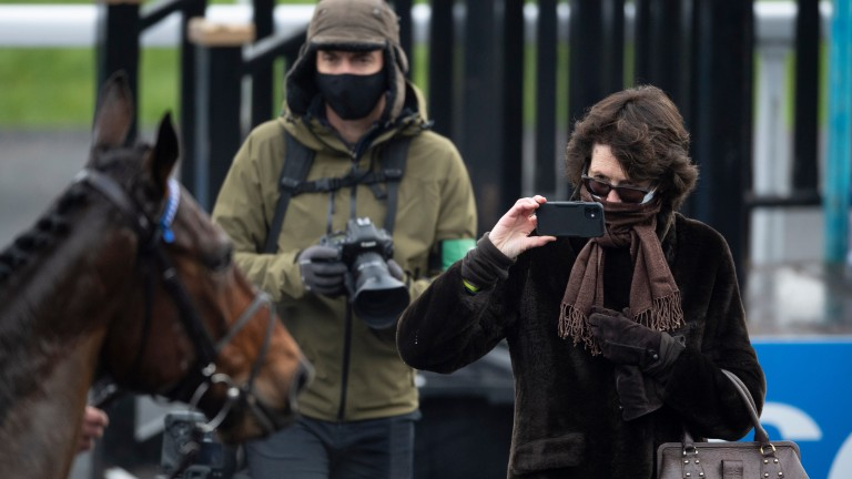 Trainer Venetia Williams gets a snap of Cepage after his victory