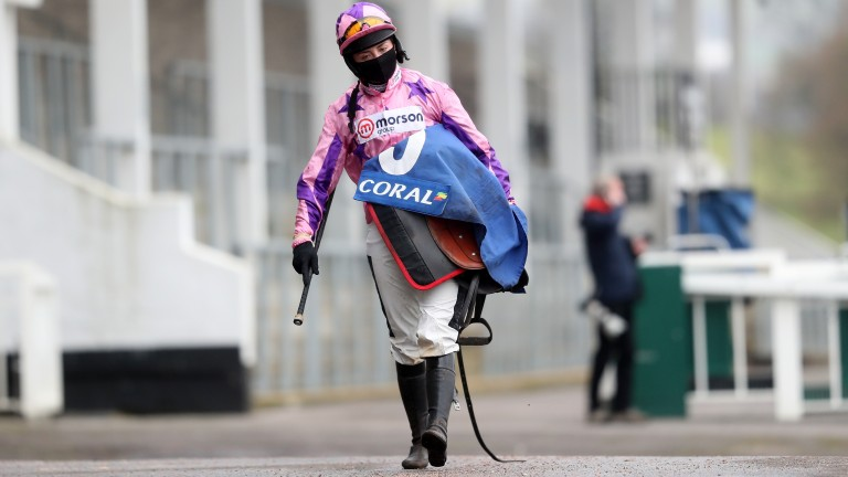 Bryony Frost makes her way back to the weighing room after winning on Storm Arising