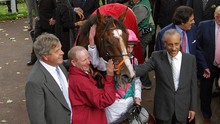 Workforce and Ryan Moore, winners of Qatar Prix de l'Arc de Triomphe, with owner-breeder Prince Khalid Abdullah and Sir Michael Stoute in 2010