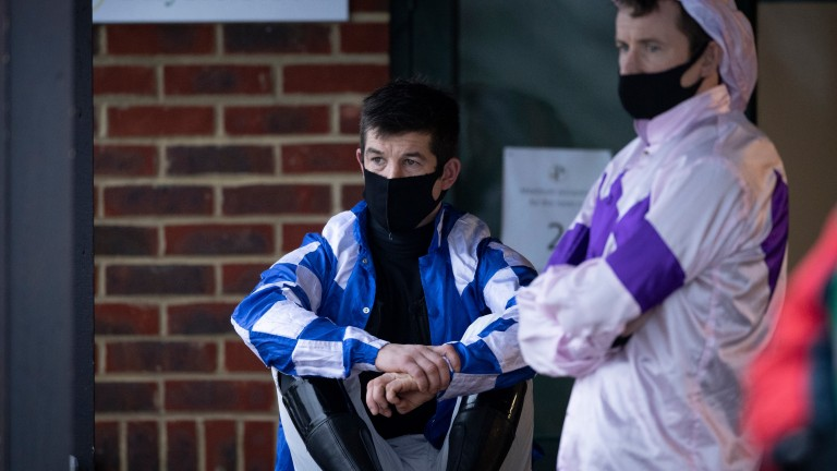 "Robbie Dunne (sitting) at Plumpton on Wednesday: ""Most jockeys work on the basis that what happens in the weighing room stays in the weighing room"""