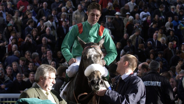 Christophe Soumillon and Dalakhani in the Longchamp winner's enclosure after their Arc success